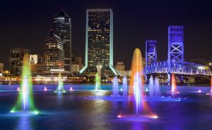 Jacksonville, Friendship Fountain and cityscape at dusk in Florida USA.  Downtown city sky line from the south bank of the St. Johns River